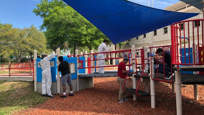 The Immokalee lacrosse team works on playground equipment at the Shriners Hospital for Children in Tampa on March 13.