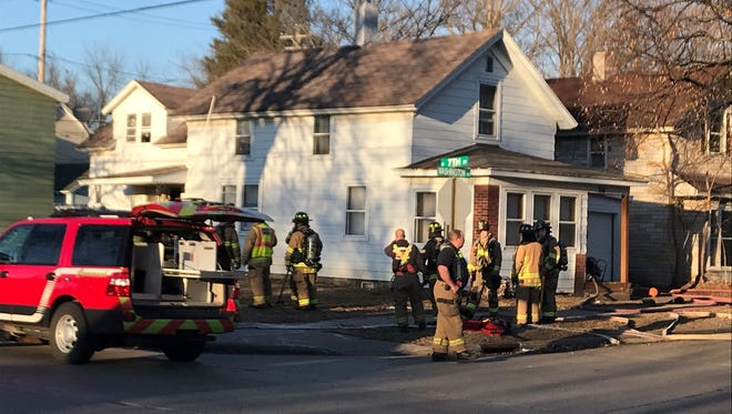 Firefighters respond to a house for at 706 Washington St. on the city's east side.