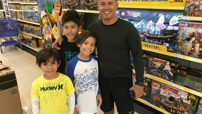 Luis Crespo and his sons, from left, Dylan, Luis and Alex, came to the Toys R Us in Totowa on Thursday, March 22, 2018, for the expected liquidation sales, only to find they had been delayed.