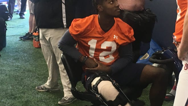 Auburn wide receiver Eli Stove, who suffered a torn anterior cruciate ligament during practice, is in a full knee brace and will miss the rest of spring drills.
