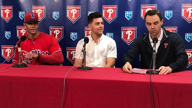 Scott Kingery signed a contract Monday and will make the Phillies' opening day roster, as manager Gabe Kapler, left, and general manager Matt Klentak look on.