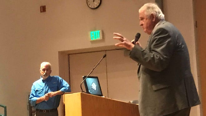 Tom Butine, left, listens as Ron Thompson discusses the Lake Powell Pipeline during a presentation at Dixie State University on Tuesday, March 27, 2018.