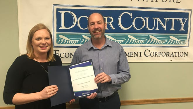 Markie Bscherer, left, former manager of the Business & Education Partnership, and Korey Mallien, current manager, pose with the award for community service work from the Wisconsin Department of Public Instruction. The partnership is a program of the Door County Economic Development Corporation.