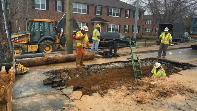 Crews work to repair a water main between the 3500 block and the 3900 block of Lancaster Pike.