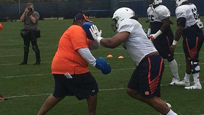 Auburn defensive line coach Rodney Garner working with defensive tackle Tyrone Truesdell.