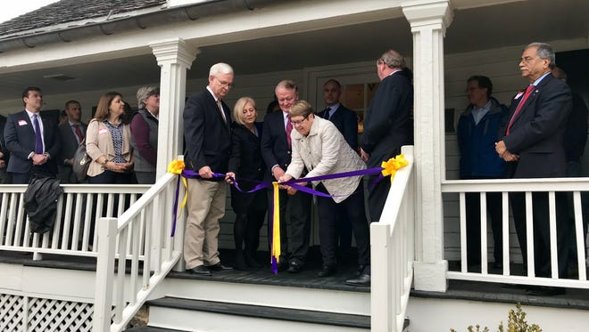 Lois Gagnon of the Lois E. & Neil J. Gagnon Foundation, a sponsor of Community in Crisis, cuts the ribbon at the official opening of Community in Crisis in Bernardsville on March 28.