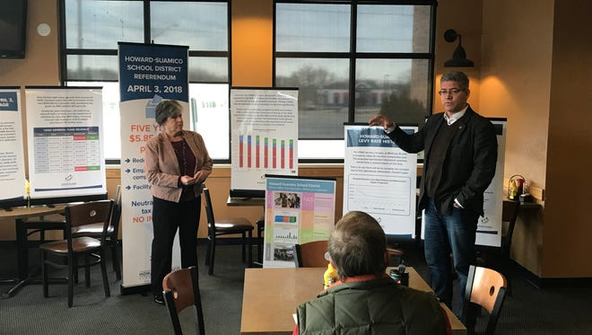 Howard-Suamico School Board Vice President Teresa Ford and Superintendent Damian LaCroix speak to a group of voters at Townline Pub & Grill in Suamico about Tuesday's referendum vote.