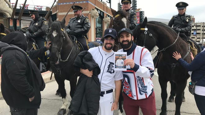Billie Giorgio and Joey Radio pose with officers and horses Friday.
