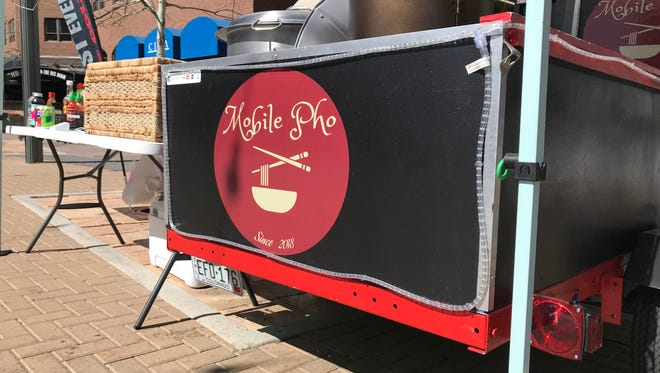 A mobile pho vendor sets up in Fort Collins' Old Town Square six days a week.