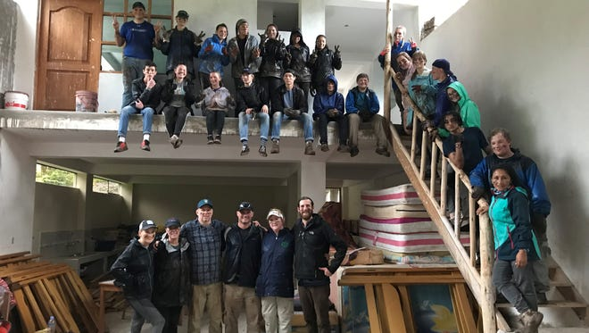 A group of students and parents from Clarksville Academy did work on a dorm in Peru, including donating mattresses and bedding for the rooms.