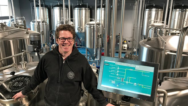 Dr. Scott Kelley, co-owner and brewmaster with Raised Grain Brewing Company, got his start in brewing beer about 10 years ago.