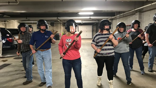 "Citizens Academy students form a ""wedge,"" one of many crowd control formations they learned Tuesday."