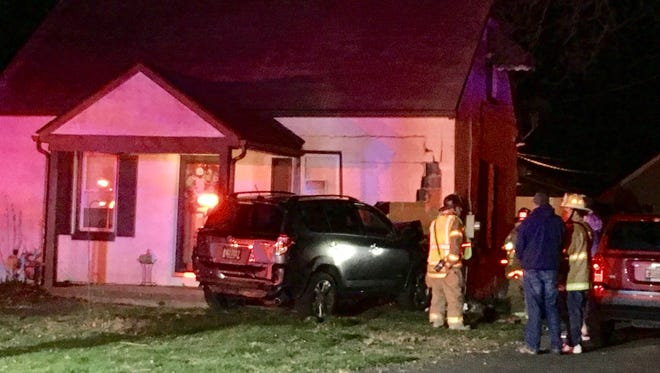 A vehicle crashed into a Minquadale home Sunday morning.