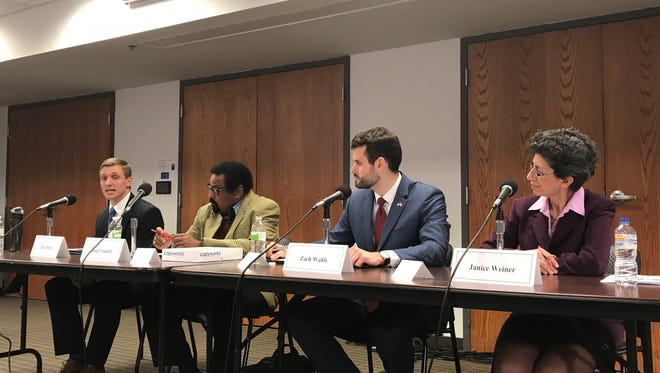 The Democratic candidates for the District 37 Senate seat gathered at the Coralville Public Library on Monday.