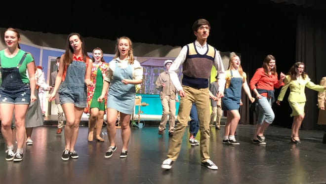 "Nick White as Seymour leads the cast through the opening scene of ""Little Shop of Horrors"" during a recent rehearsal."