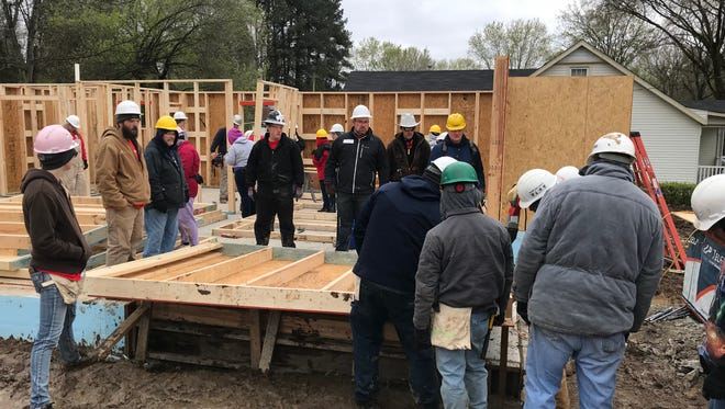 Volunteers from Gateway Church Assembly of God work on a Habitat for Humanity home in Ashland City on Saturday, April 7.
