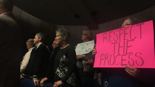 Residents of the Driftwood Hills neighborhood protested an agreement between Nora community groups and a realtor to develop a heavily wooded parcel for commercial use.