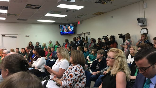The conference room at the Leon County Schools' Howell Building was filled with charter-school supporters in green.
