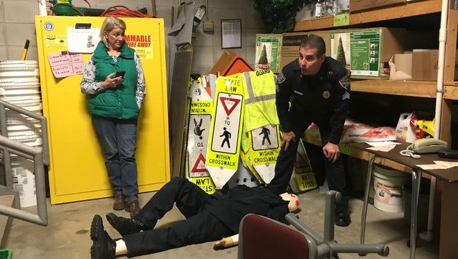 Manitowoc Police Sgt. Bruce Jacobs shows details in a mock crime scene for Citizens Academy April 10, 2018.
