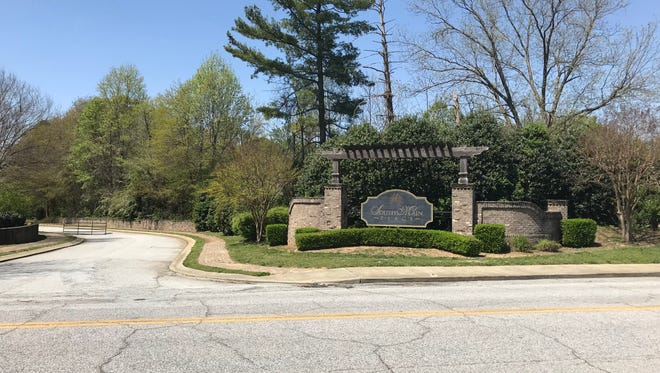 The sign for a planned development near downtown Simpsonville still stands more than five years later, but there's no sign of construction.