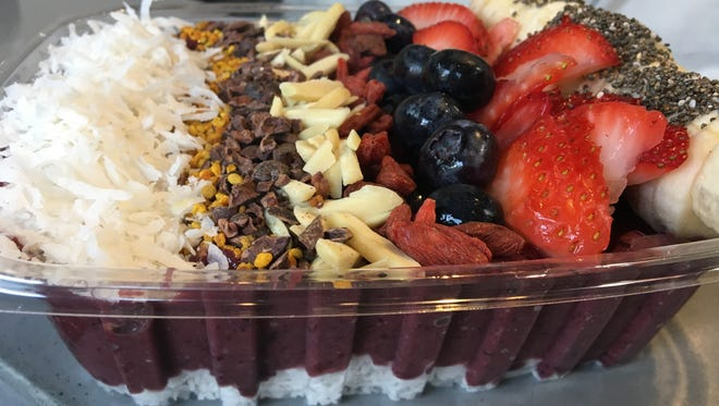 An acai bowl is made from fruit paste typically thicker than a smoothie and topped with a variety of fruits, nuts and superfoods.