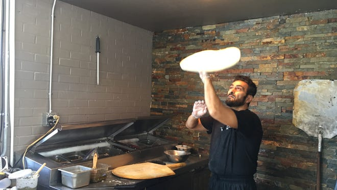 Sami Ihmaidan hand tosses every pizza at Sami's Brick Oven Pizzeria in Murfreesboro.