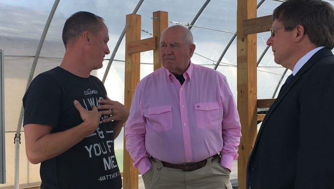 Cul2vate garden director Joey Lankford, talks to U.S. Ag Secretary Sonny Perdue (middle) and Tennessee Agriculture Department Commissioner Jai Templeton about his organization's mission on April 13, 2018.