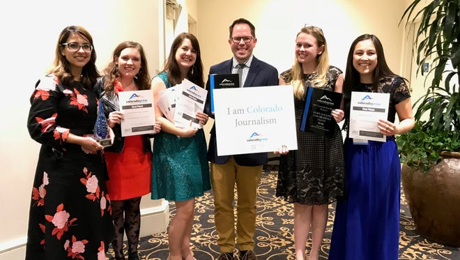 Coloradoan reporters Saja Hindi and Jacy Marmaduke, content coach Sarah Kyle, news director Eric Larsen, content strategist Jennifer Hefty and former Coloradoan reporter Cassa Niedringhaus hold awards from the Colorado Press Association's annual awards dinner Saturday evening.