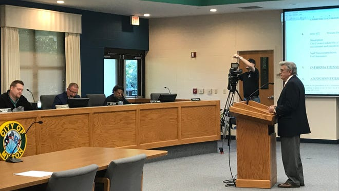 Steve Garman, right, former city manager in Pensacola and Gulf Breeze, addresses the Milton City Council on its options for finding a new city manager during a special city council meeting on Monday, April 18, 2018 at city hall in Milton.