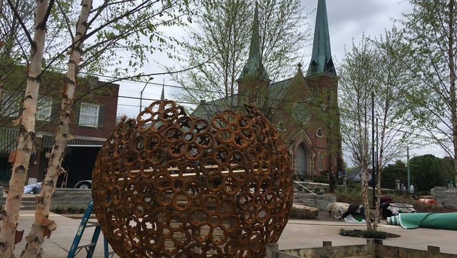 Downtown Commons is almost complete in Clarksville, including the iron sphere artwork.