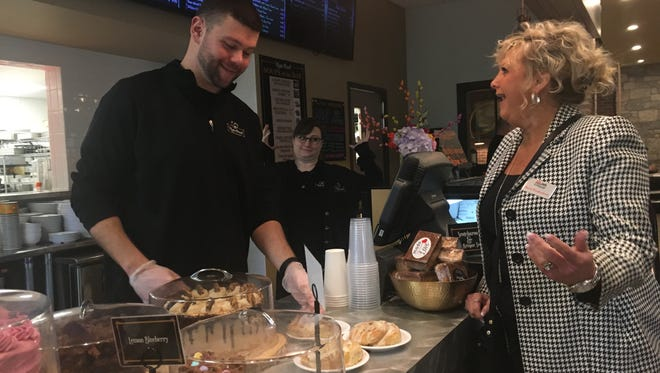 Barb Wiedenman (right) chats with Ryan McCauley (left) at Main Street Bakery & Cafe.