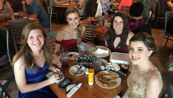 A group of high school seniors going to the Titusville High prom had their dinner paid for by a stranger, but they decided to pay it forward in a powerful way.