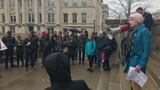Annie Sand,a rhetoric lecturer at UI, addresses the crowd of non-tenure track faculty who gathered to demand better pay and benefits.