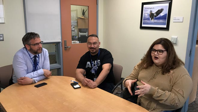 Veanka Guzman (right) with Amistad Principal David Gustafson (left) and Counselor Ralph Reyes (center) explains her experience in alternative education.