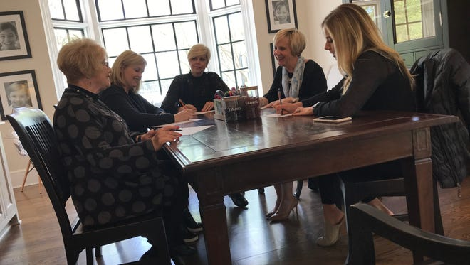 Kirkland Cancer Center board members (from left) Anita Kay Archer, Vikki Neblett, Celia Jordan, Lorie White and Caroline Campbell go over plans for the Simply Southern fundraising event that will happen on May 11 at Campbell's home.