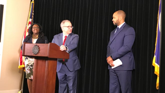 Mayor David Briley introduces Ashford Hughes Sr., right, as the city's chief diversity, equity and inclusion officer as Ashley Northington, director of DENOR Brands and Public Relations, looks on.
