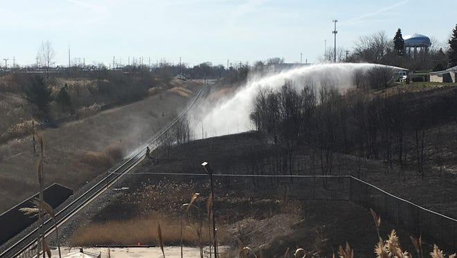 Firefighters are at the scene of a fire near railroad tracks in Port Huron.