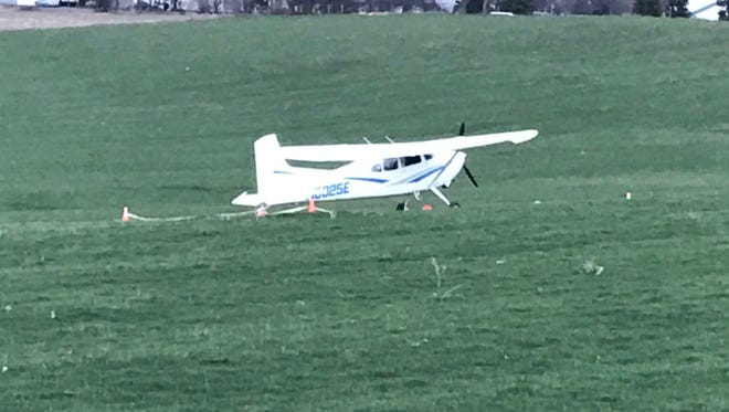 A single-engine plane landed in a Perinton field on Monday, April 23, 2018.