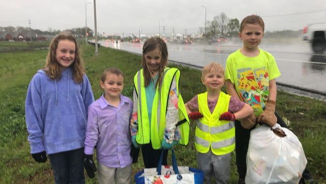 Karis Tinden, Silas Tilden, Maddie Nemec, Joey Nemec and Jimmy Nemec helped clean up Clarksville on Earth Day.