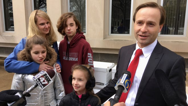 Republican gubernatorial candidate Brian Calley speaks with reporters before submitting 25,000 nominating signatures to qualify for the ballot on Tuesday, April 17, 2018, outside the secretary of state's office in Lansing, Mich. The lieutenant governor is joined by his wife, state Rep. Julie Calley, and their three children.