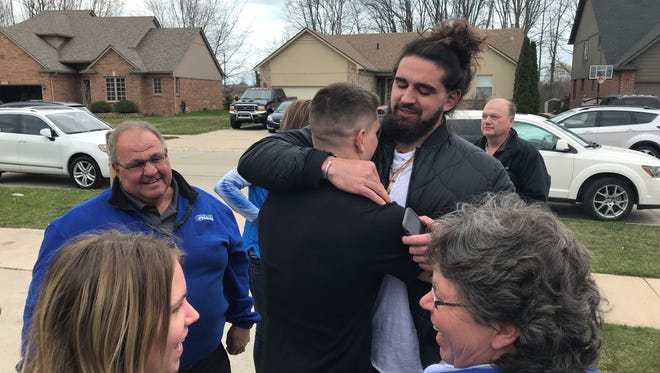 Central Michigan tight end Tyler Conklin, right, shares the moment of getting drafted by the Minnesota Vikings with family and friends at his family's home in Chesterfield Twp. on Saturday, April 28, 2018.