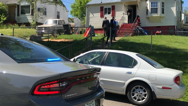 Police are investigating a drive-by shooting Monday, April 30, 2018, on South Beaman Street in East Knoxville that wounded two men while they were mowing the backyard.