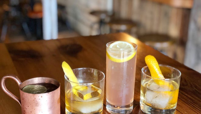 The Barrow House's Happy Hour begins at 3: left to right in the photo are the: Cherry Blossom Mule, Kentucky River, Demure for Sure, Negroni en Blanc.