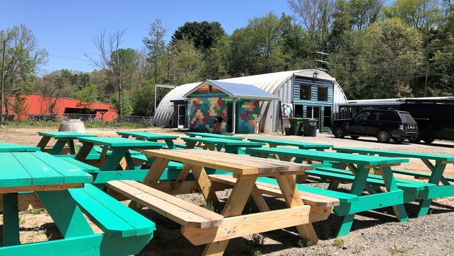 This July picture shows outdoor tables at the White Duck Taco Shop, which will likely have to be secured against the oncoming storm.