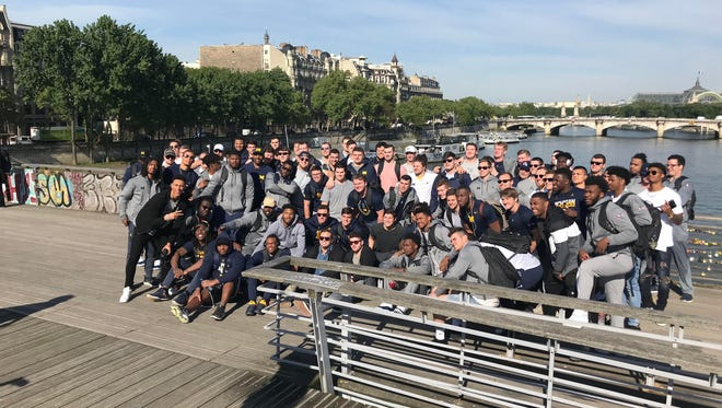 Members of the Michigan football team pose together in Paris on Wednesday, May 2, 2018.