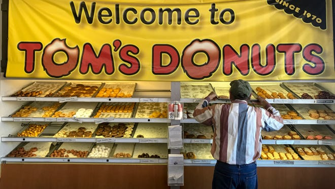 After closing in early February 2018, Tom's Donuts reopened on April 21 with new ownership but the same name, same sign and same donuts.