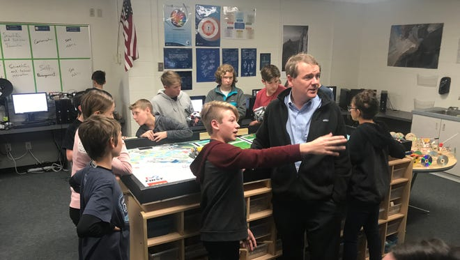 A student at Lesher Middle School in Fort Collins shows off his Lego robotics class to U.S. Sen. Michael Bennet on Thursday, May 3, 2018.