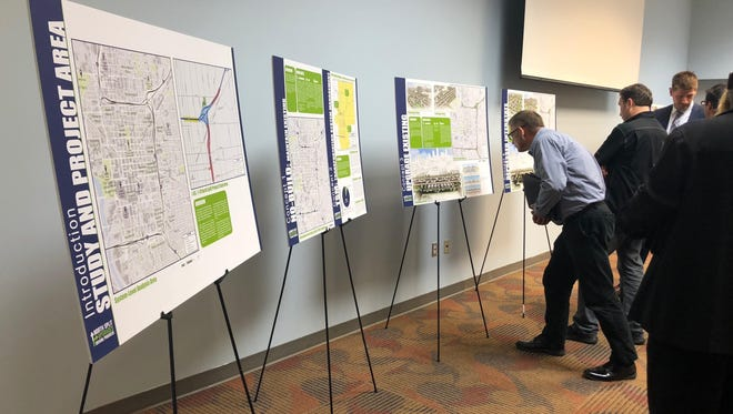 Members of the North Split Community Advisory Committee take a look at INDOT's study on seven different options for how to reimagine the interstates through Downtown Indianapolis.