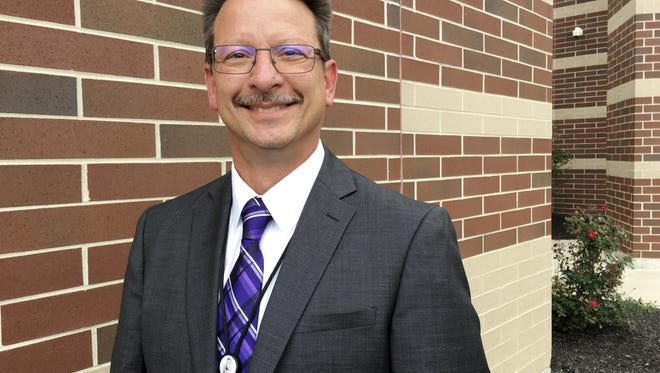 Jon Detwiler, Fremont City Schools superintendent, discussed door locks and school building plans during a meeting Monday.