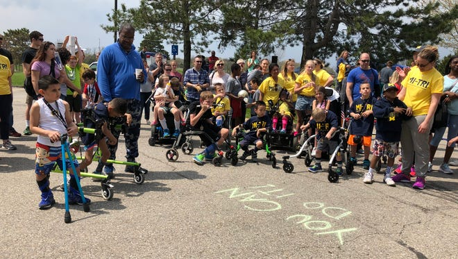 The young athletes, their families and staff at Mott Children's Hospital's first ever adaptive triathlon.